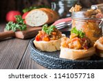 bread toasts with eggplant... | Shutterstock . vector #1141057718