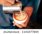 close up barista hands pouring... | Shutterstock . vector #1141077845
