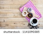 coffee cup and donuts with... | Shutterstock . vector #1141090385