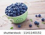 bowl full of blueberries  ... | Shutterstock . vector #1141140152