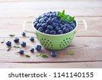 bowl full of blueberries  ... | Shutterstock . vector #1141140155