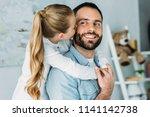 adorable little daughter... | Shutterstock . vector #1141142738