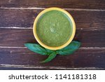 basil pesto in a yellow bowl on ... | Shutterstock . vector #1141181318