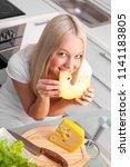 beautiful young woman eating... | Shutterstock . vector #1141183805