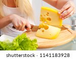 hands of a young woman eating... | Shutterstock . vector #1141183928