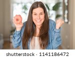 hungry young woman holding pink ... | Shutterstock . vector #1141186472