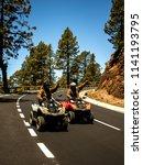 two men ride the mountain road...   Shutterstock . vector #1141193795