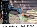 Old Rustic Water Pump With Woo...