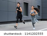 smiling asian female and male... | Shutterstock . vector #1141202555