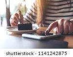 closeup image of a woman using... | Shutterstock . vector #1141242875
