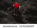 mountain rescuer helping... | Shutterstock . vector #1141260605