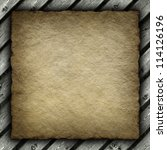 Old crumpled paper sheet on wood background - stock photo