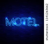 motel neon sign on the brick... | Shutterstock .eps vector #1141263662