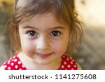 cute little girl looking at the ... | Shutterstock . vector #1141275608