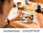 taking photo at morning... | Shutterstock . vector #1141297025
