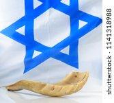 shofar horn on israel flag.... | Shutterstock . vector #1141318988