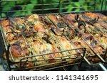 preparation of a shish kebab... | Shutterstock . vector #1141341695