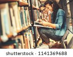two female students read and... | Shutterstock . vector #1141369688