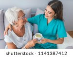 young caregiver in uniform... | Shutterstock . vector #1141387412