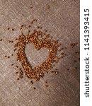 grains of buckwheat  drawing of ... | Shutterstock . vector #1141393415