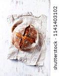 loaf of a sourdough rye bread... | Shutterstock . vector #1141403102