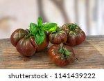 crimea black tomato isolated on ...   Shutterstock . vector #1141439222