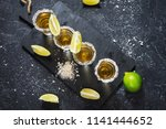 mexican gold tequila with lime... | Shutterstock . vector #1141444652