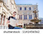 man tourist with a city map in... | Shutterstock . vector #1141456562