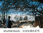 man owner checking burned and... | Shutterstock . vector #1141481375