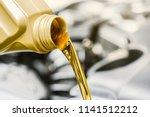 pour yellow motor oil into car... | Shutterstock . vector #1141512212