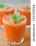 cold tomato soup in glass jars - stock photo