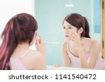 woman look mirror and touch her ... | Shutterstock . vector #1141540472