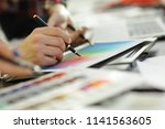 close up.a group of designers... | Shutterstock . vector #1141563605