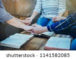 a christian group holding hands ... | Shutterstock . vector #1141582085