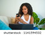 lifestyle portrait of young... | Shutterstock . vector #1141594532