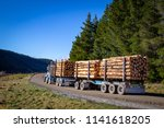 a loaded logging truck leaves...