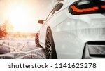 white car in the snow. 3d... | Shutterstock . vector #1141623278