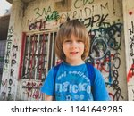 boy goes to school with... | Shutterstock . vector #1141649285