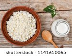 home cottage cheese and a jug... | Shutterstock . vector #1141650065
