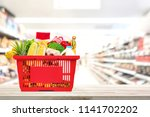 food and groceries in red... | Shutterstock . vector #1141702202