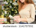 girl return back money to...   Shutterstock . vector #1141757552