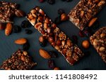 Stock photo healthy snacks fitness lifestyle and high fiber diet concept with granola energy bars surrounded 1141808492