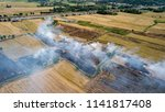 smoke from burning rice stubble ... | Shutterstock . vector #1141817408