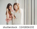 two young asian business woman... | Shutterstock . vector #1141826132