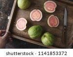 fresh ripe guava with rustic... | Shutterstock . vector #1141853372