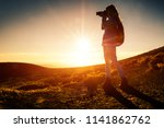 woman hiker with backpack takes ... | Shutterstock . vector #1141862762
