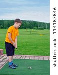 young boy playing golf in the... | Shutterstock . vector #114187846