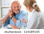 doctor talking to her male... | Shutterstock . vector #114189145