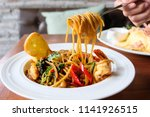 spaghetti with spicy mixed... | Shutterstock . vector #1141926515