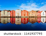 colorful old houses at the...   Shutterstock . vector #1141937795